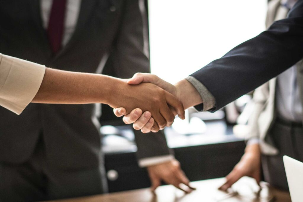 Collaboration photo of business professionals shaking hands